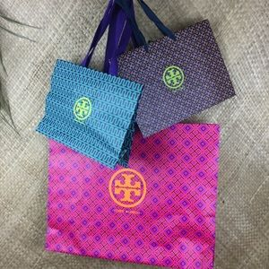 3 Tory Burch assorted color shopping bags